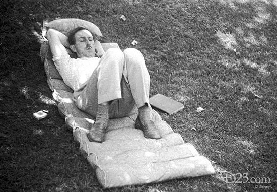 This never-before-released photo, taken with Walt's personal camera, show Walt sleeping in the shade on the lawn of his Woking Way home on a state-of-the-art '40-s cushion—a book at his side.
